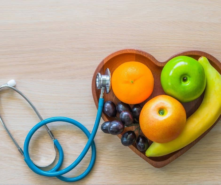 Fruits with stethoscope as part of personal nutritional support